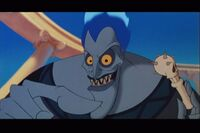 Hades holding a skull pacifier before attempting to put it into Baby Hercules' mouth