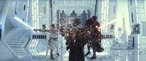 Rey and Kylo Ren destroy Darth Vader's burned mask and helmet