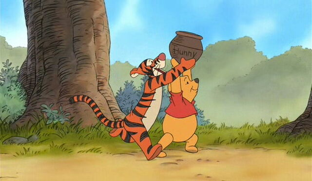 File:Tigger and Pooh Bear are both getting the honey.jpg