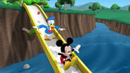 Mickey, donald and baby red bird slide on the slide