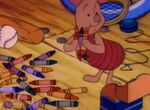 Piglet picking up crayons