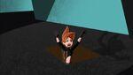 Kim falls down trap door