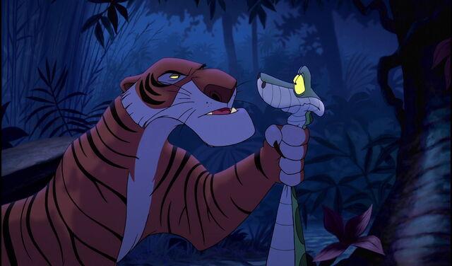 File:Shere Khan interrogating Kaa on Mowgli's whereabouts.jpg