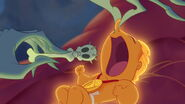 With his nose pinched, Hercules opens his mouth as Hades attempts to put the pacifier in