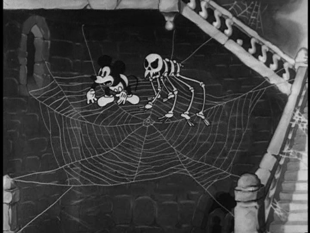 File:Mickey with skeleton on a cobweb.png