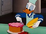 Donald putting icing on a cake