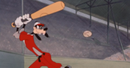 Goofy about to hit baseball