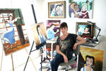 Paige O' Hara with her Belle paintings