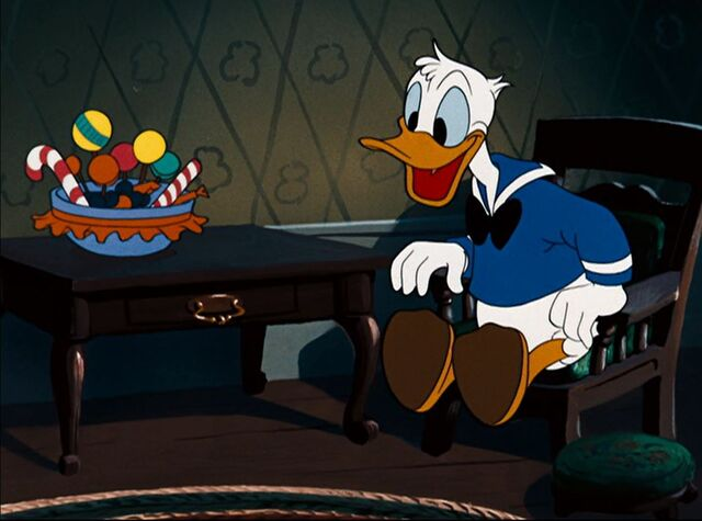 File:Donald Duck with candy.jpg