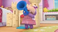 Hallie blows a horn