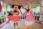 Minnie with Daisy