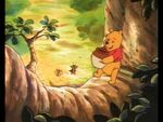 Winnie the Pooh is up in the honey tree