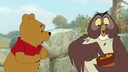 Winnie the Pooh has his honeypot taken away by Owl