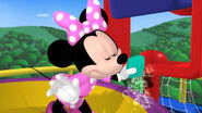 Minnie cleans the web out