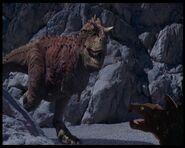 Stegosauro di Fantasia contro Carnotauro di Dinosauri