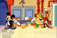 Mickey holding Donald back