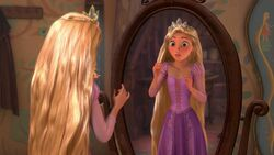Rapunzel tries on the crown