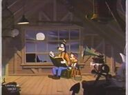Goofy and son looking in book