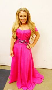 Chloë Agnew in a hot pink dress