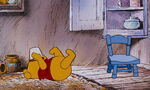 Winnie the Pooh is trying to get the last bit in the honeypot