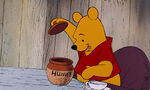 Winnie the Pooh is about to help himself to the honey
