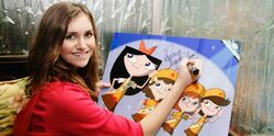 Alyson Stoner signs artwork of the Fireside Girls