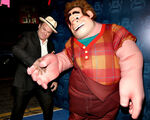 John C. Reilly shakes hands with Wreck-It Ralph