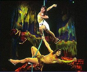 Tarzan and Jane swing through the jungle