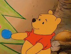 Pooh with his Christmas tree