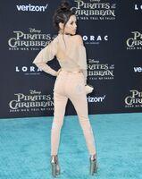 Jenna-Ortega-in-Customized-Topshop-Pants-and-Sky-High-Steve-Madden-Heels