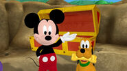 Mickey and pluto with a golden bone