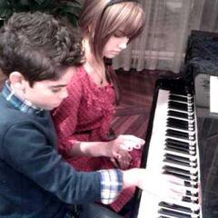 debby ryan and cameron boyce playing in piano