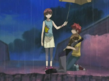 Episode 16 Riku protects Daisuke and Risa with her umbrella