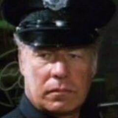 Sargento Lew Slade (<a href=