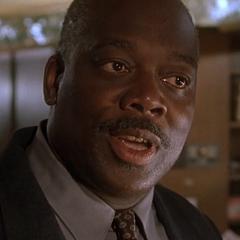Agente Bilkins en la primera película de <a href=