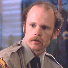 Oficial Bill Briggs (<a href=