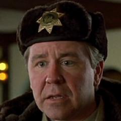 Oficial Olson en la versión de Roitman Group de <a href=