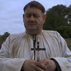 Sacerdote en el funeral también en el redoblaje de <a href=