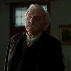 Edmund Tuttle en <a href=