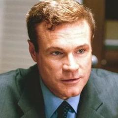Detective John Mulchaey en la segunda adaptación de <a href=