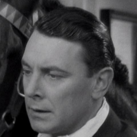 Jack Townsend (George Brent) en <a href=