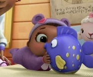 Cece McStuffins plays with Squeakers