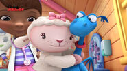 Lambie hugging stuffy