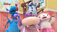 Four toy characters singing
