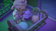 Lambie puts the bouncy babies in their crib