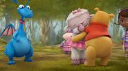 Lambie gives winnie the pooh a cuddle
