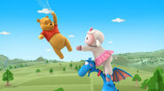 Lambie tries to grab winnie the pooh