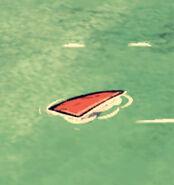 Акулий плавник в воде