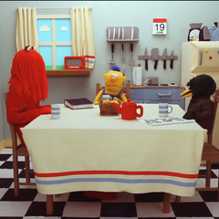 The puppets sitting in the kitchen