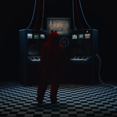 Red Guy standing in front of the control panel.